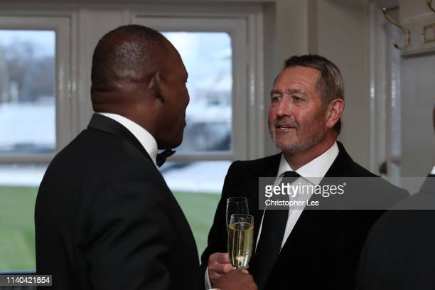 Devon Malcolm and Graham Gooch chat during the PCA Season Launch Dinner at Lord's Cricket Ground on April 04 2019 in London England