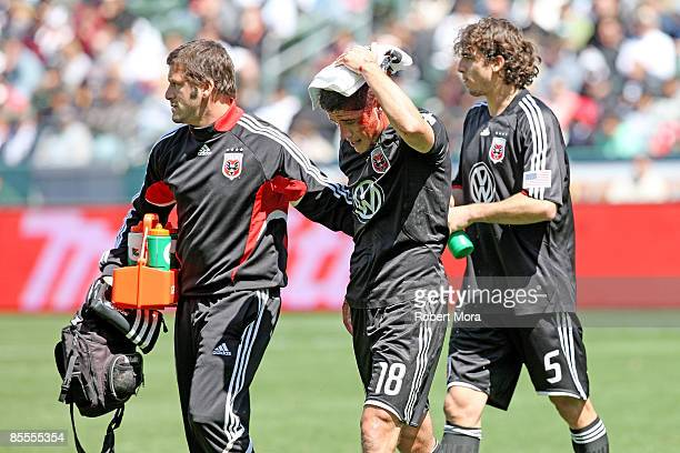 Devon McTavish of DC United is helped off the field after a collision with a teammate during their MLS game against the Los Angeles Galaxy at Home...