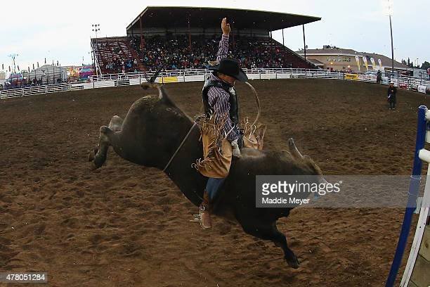Devon Mezie of Big Valley Alberta competes in the 'Battle for the Buckle' bull riding competition during the 62nd Annual Wainwright Stampede on June...