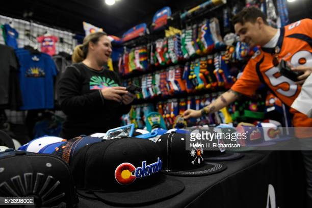 DENVER CO NOVEMBER 12 Devon Parish left sells high quality socks hats shirts from Aksels a Colorado company at the 26th annual Colorado Ski and...