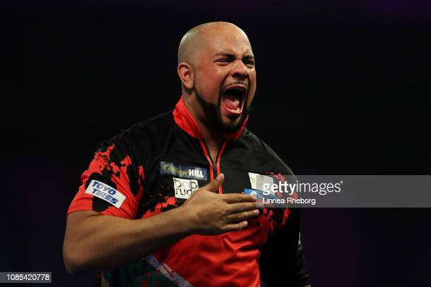 Devon Petersen of South Africa celebrates after winning his second round match against Ian White of England during Day Nine of the 2019 William Hill...