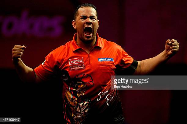 Devon Petersen of South Africa celebrates defeating Steve Beaton of England during his first round match on day four of the 2014 Ladbrokescom World...