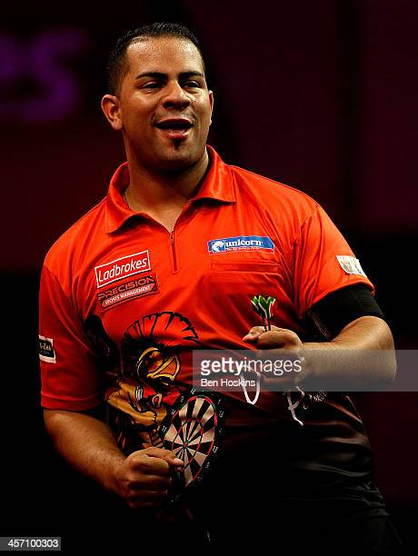 Devon Petersen of South Africa celebrates winning a set during his first round match against Steve Beaton of England day four of the 2014...