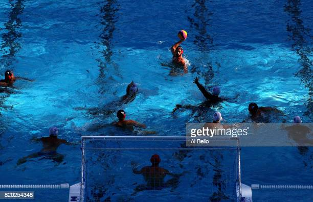 Devon Ross Thumwood of Canada takes a shot on goal during the Men's Water Polo Group A preliminary round match between Brazil and Canada on day eight...