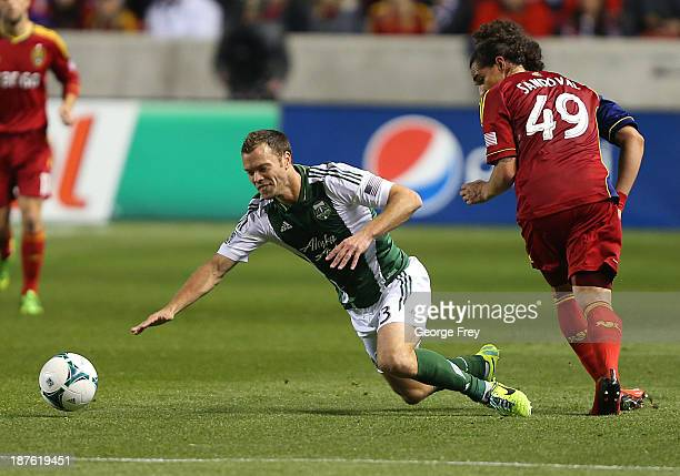 Devon Sandoval of Real Salt Lake pushes Jack Jewsbury of the Portland Timbers to the ground during the first half of the Western Conference...