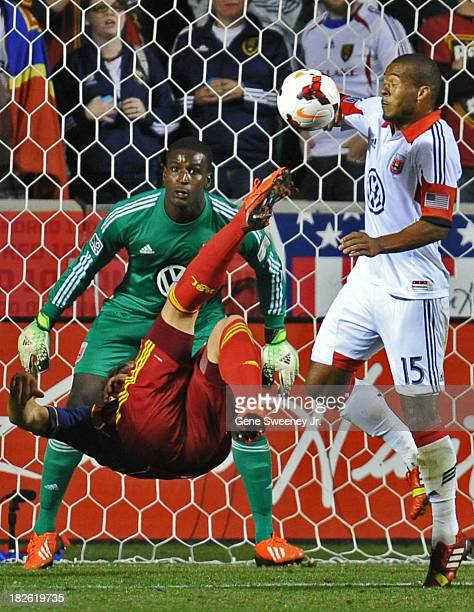 Devon Sandoval of Real Salt Lake scissor kicks the ball at goalie Bill Hamid of DC United and Ethan White of DC United at Rio Tinto Stadium October 1...