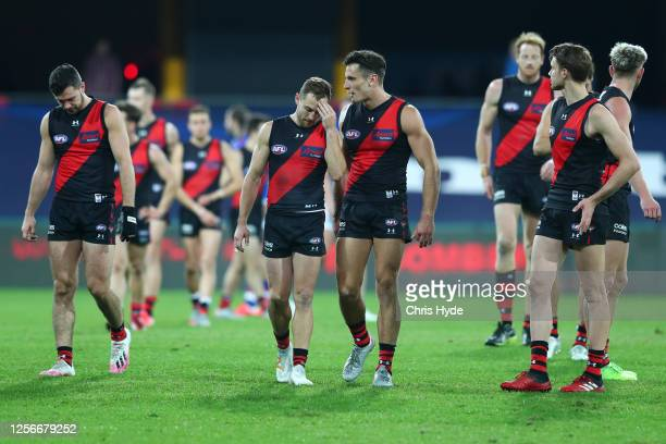 Devon Smith and Mitch Hibberd of the Bombers leave the field after losing the round 7 AFL match between the Essendon Bombers and the Western Bulldogs...