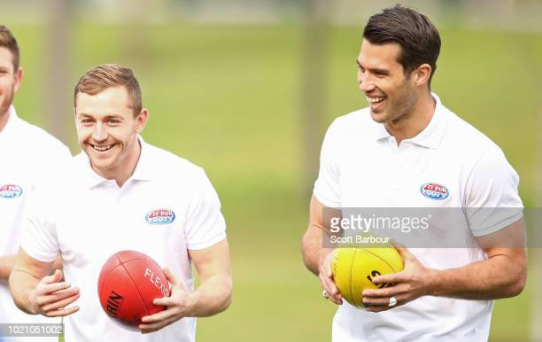 Devon Smith of the Bombers and Alex Rance of the Tigers look on during a 'Fit For Footy' launch at Gosch's Paddock on August 22 2018 in Melbourne...