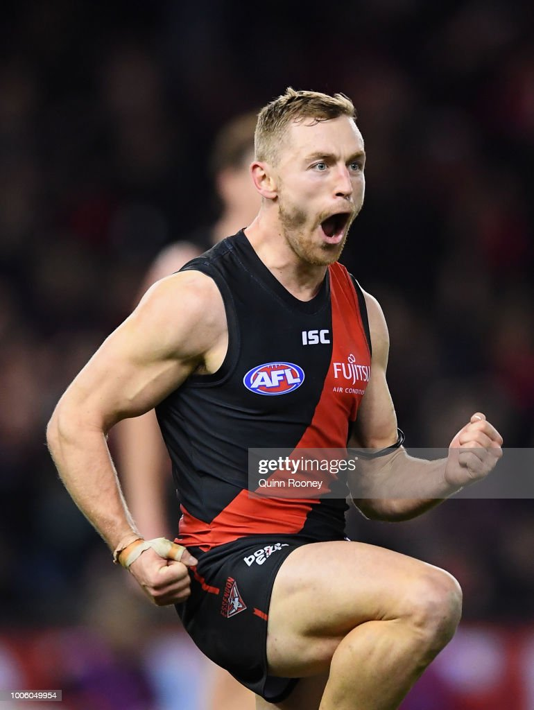Devon Smith of the Bombers celebrates kicking a goal during the round 19 AFL match between the Essendon Bombers and the Sydney Swans at Etihad Stadium on July 27, 2018 in Melbourne, Australia.
