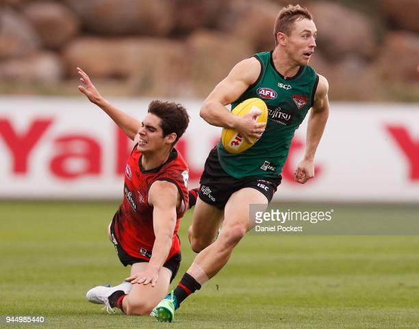 Devon Smith of the Bombers runs with the ball during an Essendon Bombers AFL training session at the Essendon Football Club on April 12 2018 in...