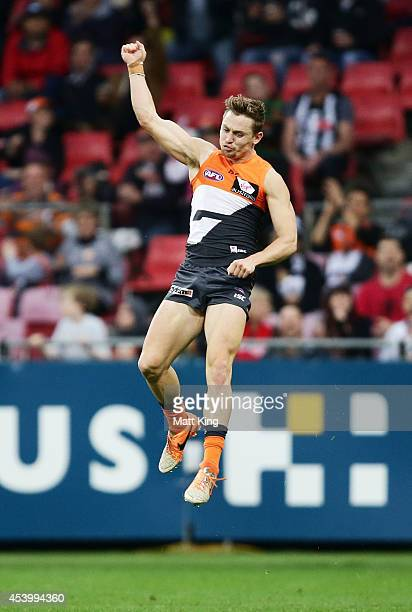 Devon Smith of the Giants celebrates a goal during the round 22 AFL match between the Greater Western Sydney Giants and the Collingwood Magpies at...