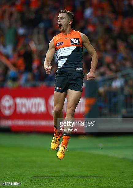 Devon Smith of the Giants celebrates a goal during the round six AFL match between the Greater Western Giants and the Hawthorn Hawks at Spotless...