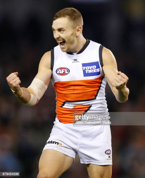 Devon Smith of the Giants celebrates a goal in his 100th game during the 2017 AFL round 07 match between the St Kilda Saints and the GWS Giants at...