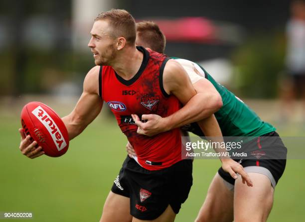 Devon Smith of the Giants is tackled by Martin Gleeson of the Bombers during the Essendon Bombers training session at The Hangar on January 12 2018...