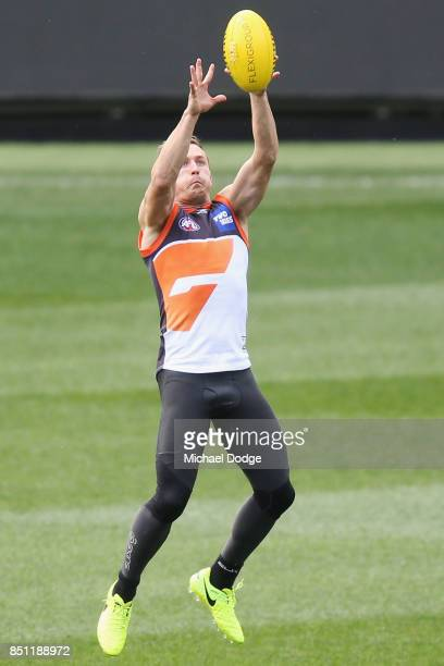 Devon Smith of the Giants marks the ball during the Greater Western Sydney Giants AFL training session at Melbourne Cricket Ground on September 22...