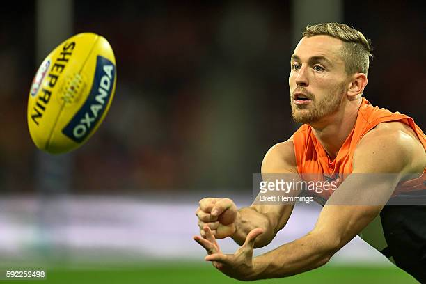 Devon Smith of the Giants passes the ball during the roUnd 22 AFL match between the Greater Western Sydney Giants and the Fremantle Dockers at...