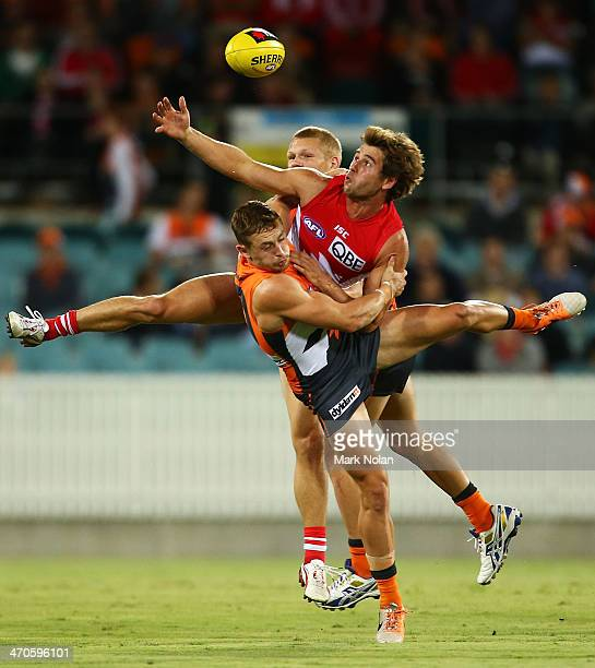 Devon Smith of the Giants tackles Nick Smith of the Swans during the round two NAB Cup AFL match between the Greater Western Sydney Giants and the...