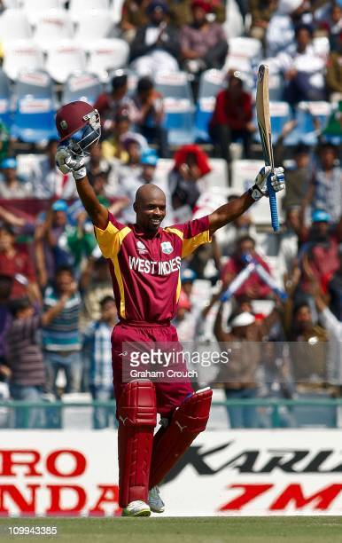 Devon Smith of West Indies celebrates reaching his century during the 2011 ICC World Cup Group B match between Ireland and the West Indies at Punjab...
