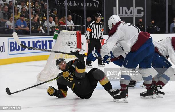 Devon Toews of the Colorado Avalanche hits Jonathan Marchessault of the Vegas Golden Knights during the first period in Game Three of the Second...