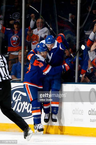 Devon Toews of the New York Islanders is congratulated by his teammate Michael Dal Colle after scoring a second period goal against the Ottawa...