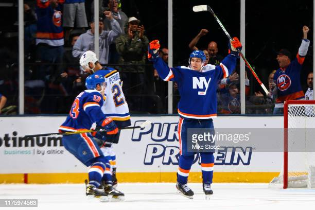 Devon Toews of the New York Islanders is congratulated by his teammate Mathew Barzal after scoring the gamewinning goal in overtime against the St...