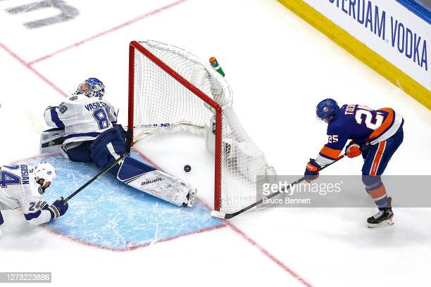 Devon Toews of the New York Islanders scores a goal past Andrei Vasilevskiy of the Tampa Bay Lightning during the first period in Game Six of the...