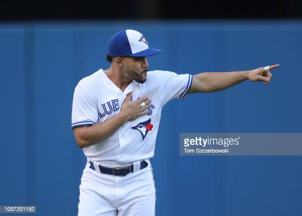 Devon Travis of the Toronto Blue Jays as he warms up before the start of MLB game action against the Tampa Bay Rays at Rogers Centre on September 4...