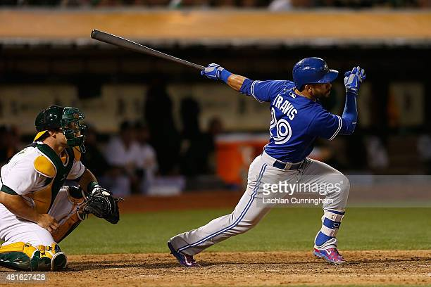 Devon Travis of the Toronto Blue Jays at bat in the ninth inning against the Oakland Athletics at Oco Coliseum on July 22 2015 in Oakland California