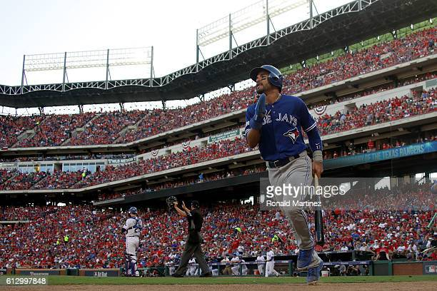 Devon Travis of the Toronto Blue Jays celebrates after scoring a run off of Josh Donaldson single to right field against Cole Hamels of the Texas...