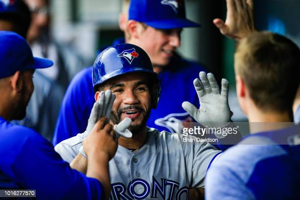 Devon Travis of the Toronto Blue Jays celebrates hitting a home run against the Kansas City Royals during the first inning at Kauffman Stadium on...