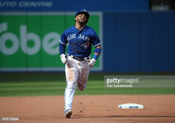Devon Travis of the Toronto Blue Jays circles the bases after hitting a tworun home run in the fifth inning during MLB game action against the...