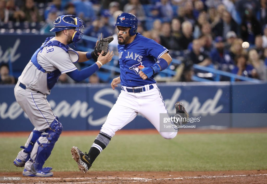Devon Travis #29 of the Toronto Blue Jays crosses home plate as he scores a run on a sacrifice fly RBI by Yangervis Solarte #26 in the sixth inning during MLB game action against the Kansas City Royals at Rogers Centre on April 17, 2018 in Toronto, Canada.