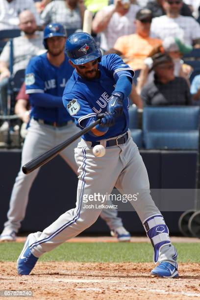 Devon Travis of the Toronto Blue Jays doubles during the spring training game between the Toronto Blue Jays and the New York Yankees at George M...