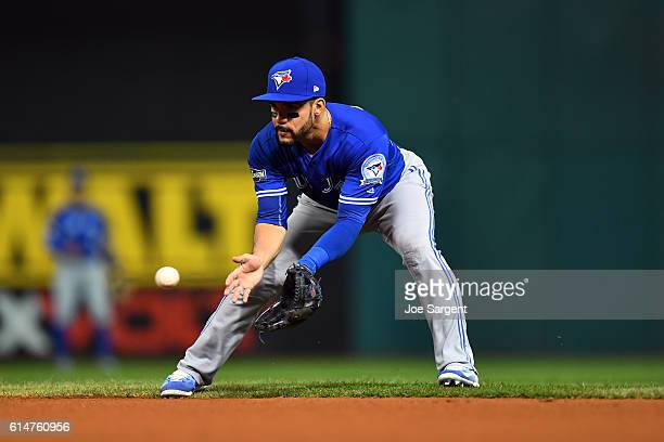 Devon Travis of the Toronto Blue Jays field a ground ball in the second inning during Game 1 of ALCS against the Cleveland Indians at Progressive...