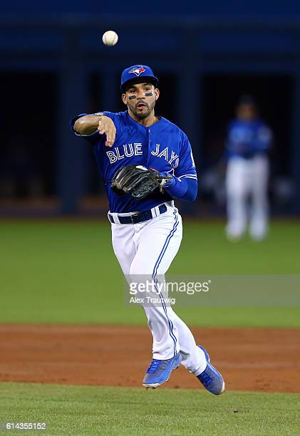 Devon Travis of the Toronto Blue Jays fields a ground ball during the American League Wild Card Game against the Baltimore Orioles at the Rogers...