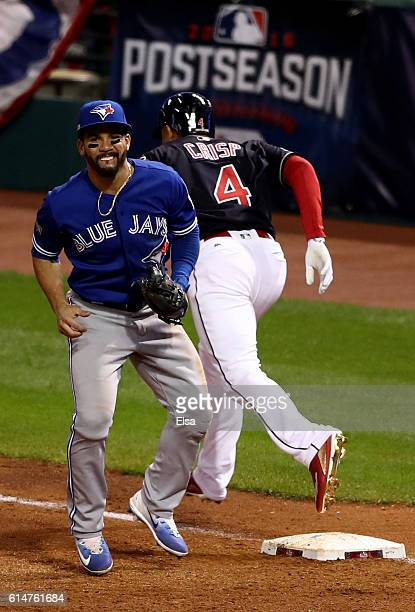 Devon Travis of the Toronto Blue Jays gets injured tagging out Coco Crisp of the Cleveland Indians in the fifth inning during game one of the...