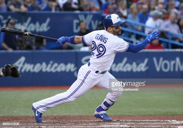Devon Travis of the Toronto Blue Jays hits a single in the third inning during MLB game action against the New York Yankees at Rogers Centre on June...