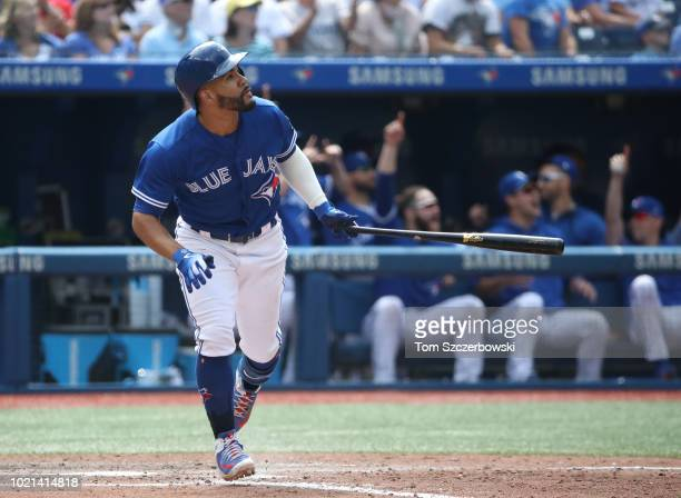 Devon Travis of the Toronto Blue Jays hits a threerun home run in the eighth inning during MLB game action against the Baltimore Orioles at Rogers...