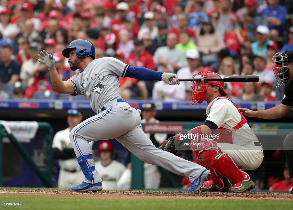 Devon Travis #29 of the Toronto Blue Jays hits a two-run double in the second inning during a game against the Philadelphia Phillies at Citizens Bank Park on May 27, 2018 in Philadelphia, Pennsylvania.