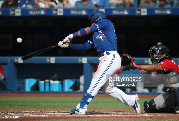 Devon Travis of the Toronto Blue Jays hits a tworun home run in the fifth inning during MLB game action against the Washington Nationals at Rogers...