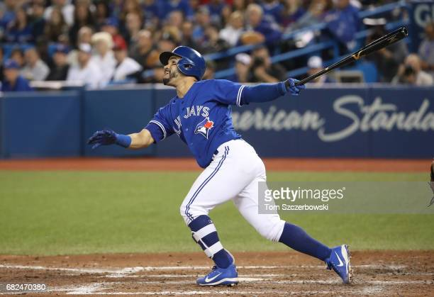 Devon Travis of the Toronto Blue Jays hits an RBI sacrifice fly in the sixth inning during MLB game action against the Seattle Mariners at Rogers...