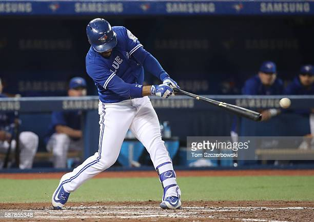 Devon Travis of the Toronto Blue Jays hits an RBI single in the fifth inning during MLB game action against the Tampa Bay Rays on August 9 2016 at...