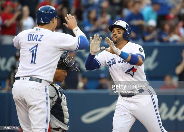 Devon Travis of the Toronto Blue Jays is congratulated by Aledmys Diaz after hitting a tworun home run in the third inning during MLB game action...