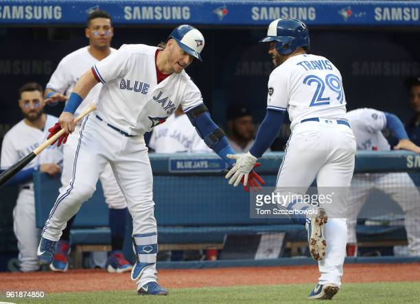 Devon Travis of the Toronto Blue Jays is congratulated by Josh Donaldson after hitting a solo home run in the third inning during MLB game action...