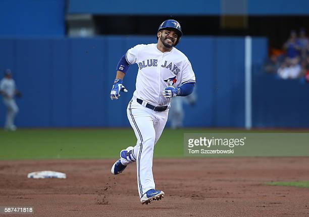Devon Travis of the Toronto Blue Jays races to third base as he legs out a triple in the first inning during MLB game action against the Tampa Bay...