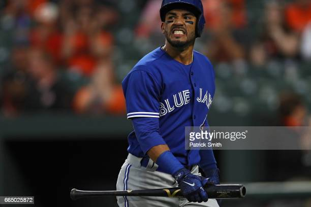Devon Travis of the Toronto Blue Jays reacts after striking out during the first inning against the Baltimore Orioles at Oriole Park at Camden Yards...