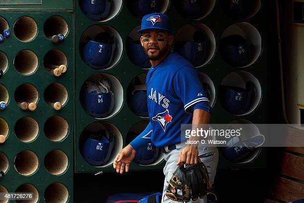 Devon Travis of the Toronto Blue Jays stands in the dugout before the game against the Oakland Athletics at Oco Coliseum on July 23 2015 in Oakland...