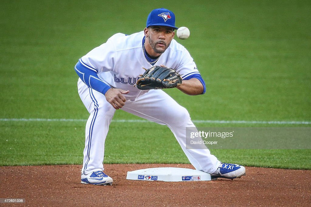 TORONTO, ON- MAY 8 - Devon Travis (29) of the Toronto Blue Jays takes a throw from Russell Martin (55) of the Toronto Blue Jays during the warm up between innings during the game between the Toronto Blue Jays and the Boston Red Sox at the Rogers Centre May 8, 2015