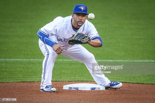 TORONTO ON MAY 8 Devon Travis of the Toronto Blue Jays takes a throw from Russell Martin of the Toronto Blue Jays during the warm up between innings...