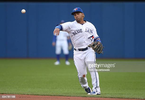 Devon Travis of the Toronto Blue Jays throws out the baserunner in the third inning during MLB game action against the Boston Red Sox on May 27 2016...